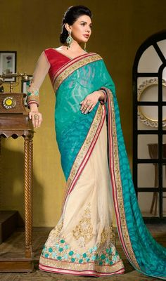 Become an enchanting secret draped in this turquoise and cream color brasso net half n half sari. The interesting lace, resham and stones work a significant feature of this attire. Upon request we can make round front/back neck and short 6 inches sleeves regular saree blouse also. #StunningTurquiseBlueAndBeigeHalfAndHalfSari