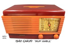 """1940 Garod model 1B55l """"Drop Handle"""" deco catalin radio, maroon with yellow trim. This deco catalin radio is unique because it is the only catalin radio that has a handle that drops flush into the cabinet. This is in perfect condition and plays with no hum."""