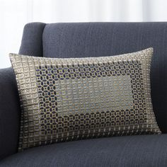 Silky embroidery patterns this stunning silk pillow with a geometric motif inspired by stone screens found on historic buildings in India. Using tonal blue and silvery yarns, highly skilled artisans take nearly an entire day to embroider one pillow. Pillow reverses to solid midnight blue. Our decorative pillows include your choice of a plush feather-down or lofty down-alternative insert at no extra cost.<br /><br /><NEWTAG/><ul><li>100% silk with 100% viscose embroidery</li><li>100% cotton…