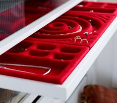 Close-up of a shallow drawer with an IKEA jewelry organizer insert.