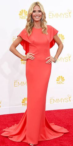 "Designer Zac Posen called Heidi Klum's custom design ""effortless and vibrant,"" and we couldn't agree more – the supermodel dazzles from every angle in the camellia-colored and caped Emmys gown."