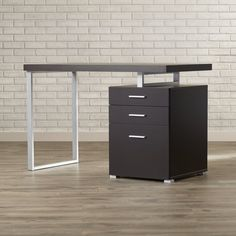 Whether you're working from home or simply scrawling a quick to do list, having a spirited space to get things done always makes them more fun. Start by switching up your style in the study with this clean-lined desk, perfect for achieving a contemporary abode. Founded upon two rectangular aluminum legs finished in silver, it features an MDF top and a convenient three drawer filing cabinet. Pull up a tufted leather rolling chair so you can relax while you work, then add a soft landing spo...