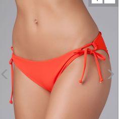 NWT orange swim bottom Loop tie side hipster bottom. Full cut. New with tags. 80% nylon, 20% spandex. Made in USA. Style: SC21F13 l*space Swim Bikinis