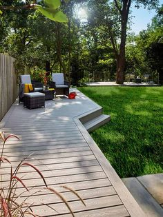 Two living areas using Trex Transcend composite decking in Gravel Path - Modern Design