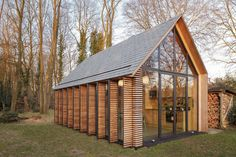 Glass-Walled Cottage with Retractable Wooden Panels