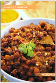 US Masala: Lal Chana Ghugni aur Tikona Paratha/Black Chickpea Curry and Paratha. Pressure cooked.  Chickpea Curry is both Gluten Free and Vegan