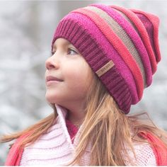 Organic Knit Children's Hat with Wool Fleece Lining - Beautiful children's hat with a chunky rib pattern. Italian made with a soft organic fleece lining to keep little ears toasty. 55% organic wool 23% silk 22% organic cotton Global Organic Textiles Standard certified.Pure pure products are manufactured from only natural fibres and without the use of harmful chemicals or unethical labour practices. Produced according to the stringent ecological, social accountability and qu...