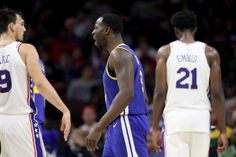 Draymond Green (23) of the Golden State Warriors argues a call in front of Dario Saric (9) and Joel Embiid (21) of the Philadelphia 76ers in the second half at Wells Fargo Center on Nov. 18, 2017 in Philadelphia. (Photo by Rob Carr/Getty Images)