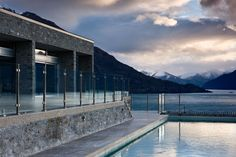 The residence was designed by Coburn Harris Butt Architecture. This large house is situated on a promontory overlooking Lake Wakatipu to the west, with the New Zealand Architecture, Architecture Photo, Residential Architecture, Building Concept, Building Design, Lake Wakatipu, Natural Building, Large Homes, Architect Design