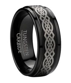 An apt choice for those seeking a Celtic ring with a twist. This men's black tungsten ring has an intricate silver tone Celtic knot design lasered down its center, handsomely framed by step down edges. This 9mm flat profile ring offers the perfect balance of modern and traditional design elements. To learn more visit: http://www.justmensrings.com/Black-Tungsten-Mens-Celtic-Knot-Ring-with-Step-Down-Edges-9mm_p_1532.html