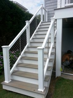 DIY Deck Railing Ideas & Designs That Are Sure to Inspire You If your favorite outdoor space is your deck, we give you over 14 inspiring Deck Railing Ideas to show how you can spruce it up, from DIY to store bought. Outside Stairs, Front Porch Railings, Deck Stairs, Wooden Stairs, Deck Railings, Aluminum Railings, Porch Balusters, Porch Roof, Exterior Stair Railing