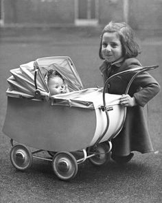 Vintage 1947 photo of young girl with her doll.
