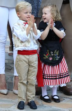 Princess Gabriella (right) looked adorable in a traditional red and white striped skirt a velvet tied waistcoat with a dark embroidered apron Princess Alexandra, Princess Caroline, Prince Albert Of Monaco, Albert Monaco, Monaco Princess, Taupe Shoes, Princess Beauty, Embroidered Apron, Charlene Of Monaco