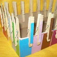 Clothespin match to strengthen fine motor skills. Letters could be written on clothespins instead for a letter matching game.