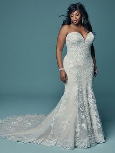Lovely lace motifs swirl over tulle in this relaxed fit-and-flare wedding dress, featuring a strapless sweetheart neckline with subtle illusion detail. Finished with covered buttons over zipper and inner corset closure. Plus Size Wedding Gowns, Modest Wedding Dresses, Designer Wedding Dresses, Bridal Dresses, Wedding Dresses For Curvy Women, Summer Dresses, Plus Size Brides, Lace Ball Gowns, Ball Dresses
