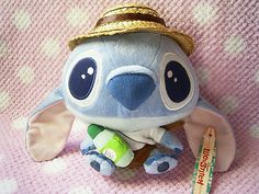 "Disney LiLo & Stitch Kawaii Summer Ver. Green Tea Plush Stuffed Doll SALE! : *condition* I didn't really use this one. However one of his feet has gotten damaged (removed some paint) due to age. So please make sure to check all of the pictures in the picture's gallery before bidding or purchasing! Released & Licensed by Disney. *Size >> About 7.1"" (18cm) in height.* 20.14-29.99 (7.90/8.50/12.50)"