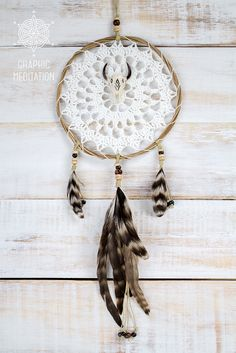 White Doily Dreamcatcher with skull pendant and feathers. Crochet boho wall decor by graphicmeditation. More dream catchers are here: www.etsy.com/shop/graphicmeditation
