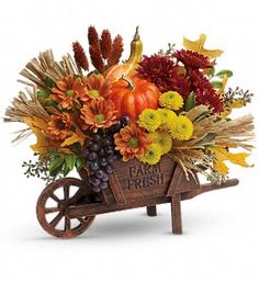 """Teleflora's Rustic Charm Bouquet Fall is here! Send your best wishes for a happy harvest with this charming """"Farm Fresh"""" wheelbarrow, bursting with a beautiful fall bouquet. Thanksgiving Flowers, Thanksgiving Centerpieces, Thanksgiving Table, Fall Flower Arrangements, Flower Centerpieces, Centerpiece Ideas, Diy Fall Wreath, Fall Wreaths, Advent Wreaths"""