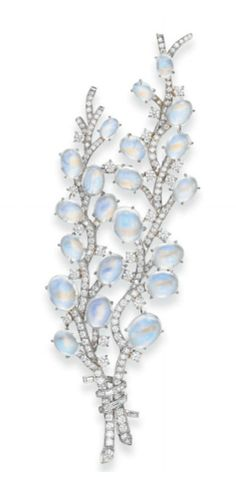 A MOONSTONE AND DIAMOND 'PUSSY WILLOW' SPRAY BROOCH, BY TIFFANY & CO.   Designed as two single and circular-cut diamond stalks set with oval cabochon moonstone blossoms, gathered by a baguette-cut diamond ribbon, mounted in platinum, in a Tiffany & Co. black suede case  Signed Tiffany & Co., no. 17650802