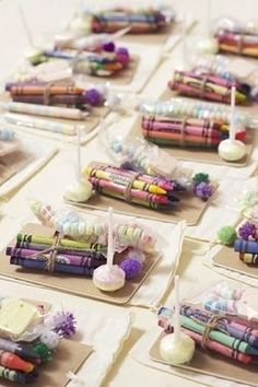 £200 kids table - sweets, colouring books, crayons, disposable cameras, ect