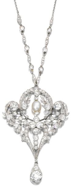DIAMOND PENDANT/NECKLACE, 1910S. Designed as an open work pendant of foliate scroll design set with circular- and single-cut diamonds, suspending a pearl and diamond drop, to a diamond and trace link chain necklace, length approximately 430mm.