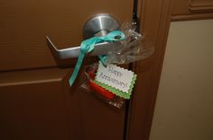 "Resident Retention - Renewal door hangers with candy, ""Happy Anniversary!"""