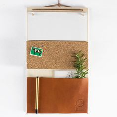 Hanging Organiser with Leather Pocket by Witshop, £35. www.oatesandco.com