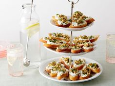 Giada dresses up these delicate Goat Cheese Toasts by topping goat cheese with chopped Kalamata olives and coarsely ground peppercorns. Best of all, the crostini and the cheese mixture can each be prepared two days ahead.