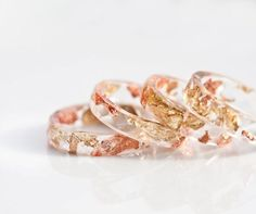 Yellow and pink gold flakes are ensconced inside this translucent ring, made out of eco-friendly resin.