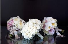 Lavender, pink, and white bridesmaids bouquets with white bridal bouquet.