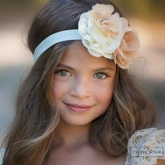 """She will feel simply divine in our """"Hazelnut Creme"""" Flower Headband.We have created the most amazing floral headband with a blend of tan and cream chiffonflowers in different sizes and textures. Each flower is then drizzled with beautiful rhinestone centers.The flowers are felt backed for extra comfort and we have put them on a soft and stretchy matching headband.Pair this headband with one of our adorable dresses for a complete look.Our Hazelnut Creme Headbandwould be perfect for…"""