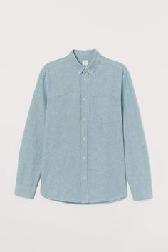 Long-sleeved shirt in washed oxford-weave cotton fabric. Button-down collar yoke at back with locker loop and chest pocket. Regular Fit – classic fit with good room for movement and gently tapered waist for a comfortable tailored silhouette. Work Casual, Men Casual, Denim Button Up, Button Up Shirts, Button Down Collar, Fashion Company, Fitness Fashion, Fall Outfits, Personal Style