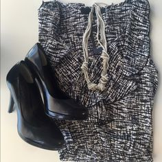 Black & White Sleeveless V-Neck Dress Black & White Sleeveless V-Neck Dress. Dress up or down. Fun print and pattern. Unlined Ruffles v-neck and elasticized waist. Missing belt but you can add any style of your choosing. BNWT; only tried on. Forever 21 Dresses