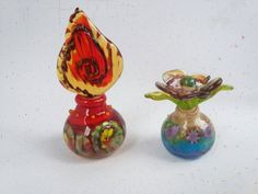 Check out this item in my Etsy shop https://www.etsy.com/uk/listing/493243895/hand-blown-miniature-perfume-bottles-by