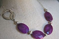 Necklace made with large purple glass faceted by HollyMackDesigns, $98.00