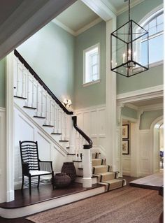Love the walls; a great way to treat high ceilings without having to overwhelm the room with one paint color; the board and batten trim work is beautiful.