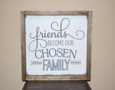 Friends become our chosen family wood sign - Family Wood Sign - Friends Wood Sign - Personalized Wood Sign  This wood sign is made to order. There may be variations in the wood since no boards are alike. A perfect gift for that special someone. Sign information: Size is 11.75 x 11.75 Pine wood Painted white with grey letters. Slightly distressed Framed  ***Want a different size? Message me. ***This sign can also be painted instead of stained. Message me for details.   ***Looking for a custom…