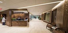 PHOTO TOUR: Chambers Center For Well Being | Healthcare Design --- The reception area at the Chambers Center for Well Being, in Morristown, N.J., features a hallway lined with real walnut wood and decorative lighting that fosters a soothing, spa-like setting. Photo: Richard Titus Photographics