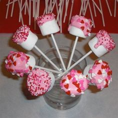 Easy Peasy!  20 Large Marshmallows  20 Lollipop Sticks (found at Walmart)  Pink Candy Melts  Valentine Sprinkles or Pink and White Sprinkles  20 clear plastic Valentines Day goodie bags... @Jenn L Milsaps Whitlock for the preschool classes v-day party? #food
