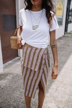 A white tee keep this statement skirt casual. We LOVE!