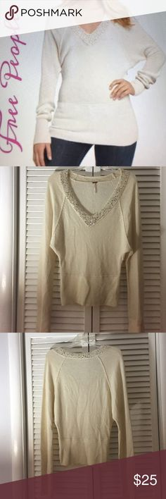 "Free People Sequin Cream V Neck Sweater Free People Sequin Cream V Neck Sweater. Pre-owned. No Holes or stains.  Size Small. Made of 72% wool 22% polyester 4% nylon 1% spandex and other fibers. 17 1/2 "" Bust 24"" L sleeves 32"". Please ask all questions prior to buying. I bundle. Free People Sweaters V-Necks"