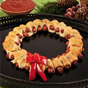 Perfectly tacky for an ugly Christmas sweater party! pigs in a blanket formed as a wreath.