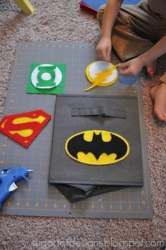 templates for superhero logos...there are packs of dolly sized bags at the $tore.