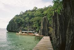 Barracuda Lake in Coron, Palawan | Taken with a Lomo LC-A+ camera loaded with Kodak Ultima 100 film #philippines #itsmorefuninthephilippines #pilipinas #pinas #pinoy #sea #sun #sunny #ocean #water #summer #nature #islands #island #mountain #mountains #boardwalk #dock #outdoors #adventure #travel #tour #tourist #green #analog #analogue #lomo #lomography #lowres #lofi | www.maypamintuan.com