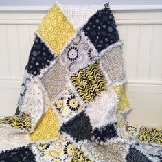 Baby Rag Quilt / Crib Quilt / Nursery Blanket / Toddler Rag Quilt  Shabby Style Cottage Chic  Ready To Ship!!  Mellow Yellow from Red Rooster  Baby/Toddler/Crib Size 35 X 42  The top of this adorable spring-like quilt features 8 different prints from the Mellow Yellow collection from Red Rooster. A combination of Yellow, white, black and gray, in a variety of modern florals and dots, this is a beautiful combination. The center layer is cotton batting, while the back is soft white flannel…