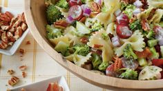 Broccoli, Grape, and Pasta Salad - Easy Pasta Salad Recipes - Southern Living - If you're a broccoli salad fan, you'll love this combination of colorful ingredients. Cook the pasta al dente so it's firm enough to hold its own when tossed with the tangy-sweet salad dressing.  Recipe:Broccoli, Grape, and Pasta Salad  Cooking Video: Easy & Delicious Broccoli, Grape, and Pasta Salad