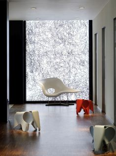 Back lit panel at end of corricor?? La Chaise Vitra  Citizen M Hotel Glasgow