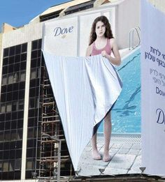 Self-Conscious Billboard Ads - The Dove 'Girl Outdoor' Ad Has a Girl Hiding Using the Ad Itself (GALLERY)