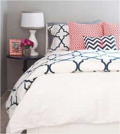 navy blue coral bathroom Love these pillows and bedspread