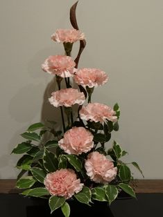 Carnations, a twisted piece of wood and some ficus foilage - keeping it simple